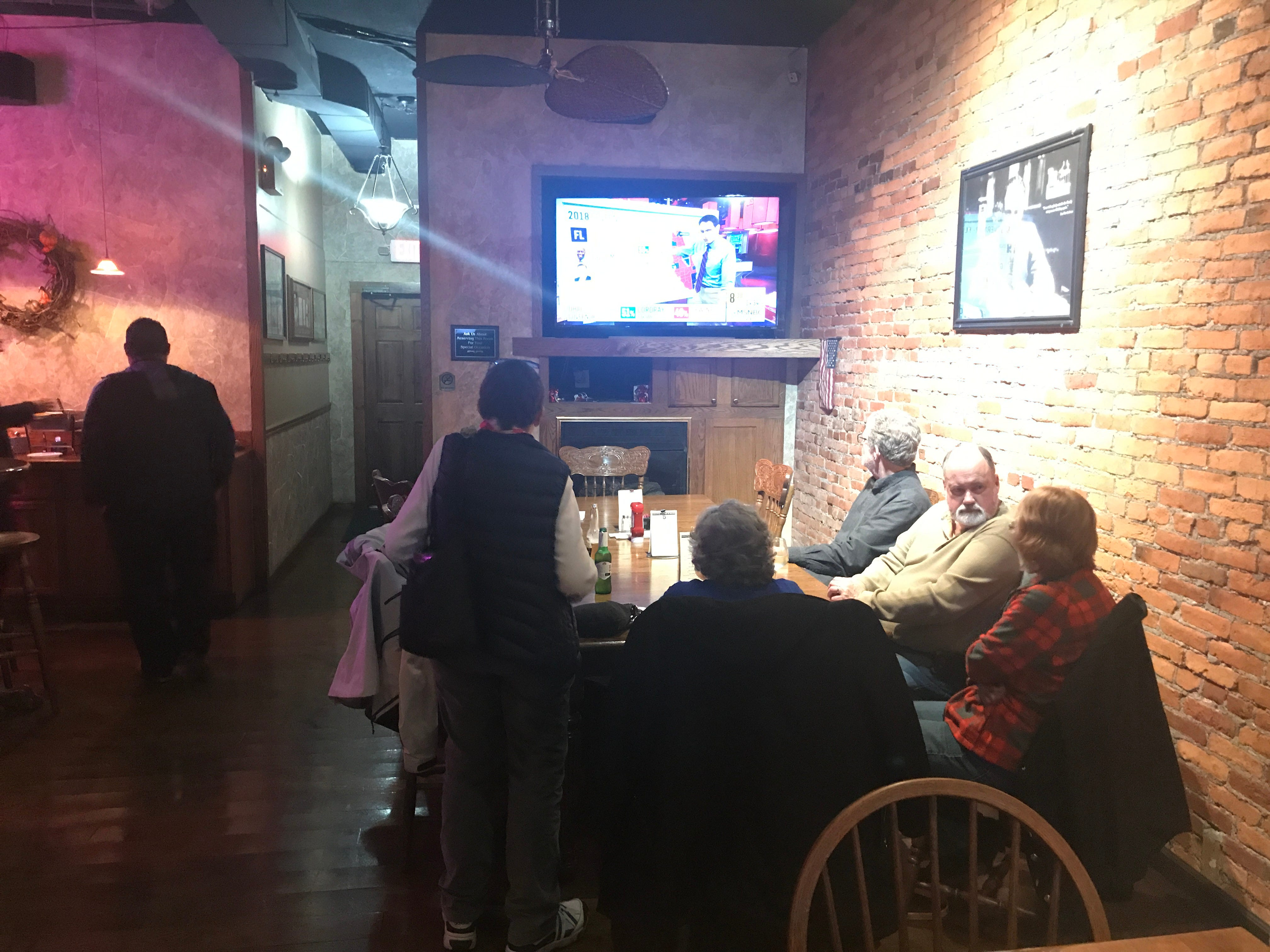 Democrats watch election results on a television at the Downtown Lounge in Lebanon on Tuesday evening.