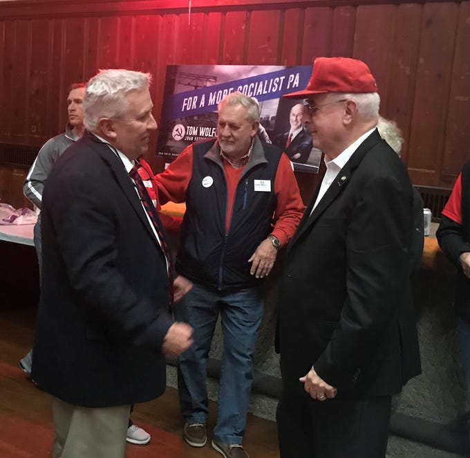 State Sen. Mike Folmer and State Rep. Frank Ryan congratulate each other on their election victories Tuesday night at the Lincoln Republican on 9th Street in Lebanon.