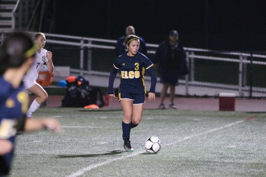 Elco's Katelyn Rueppel looks for an open teammate as she heads up the field.