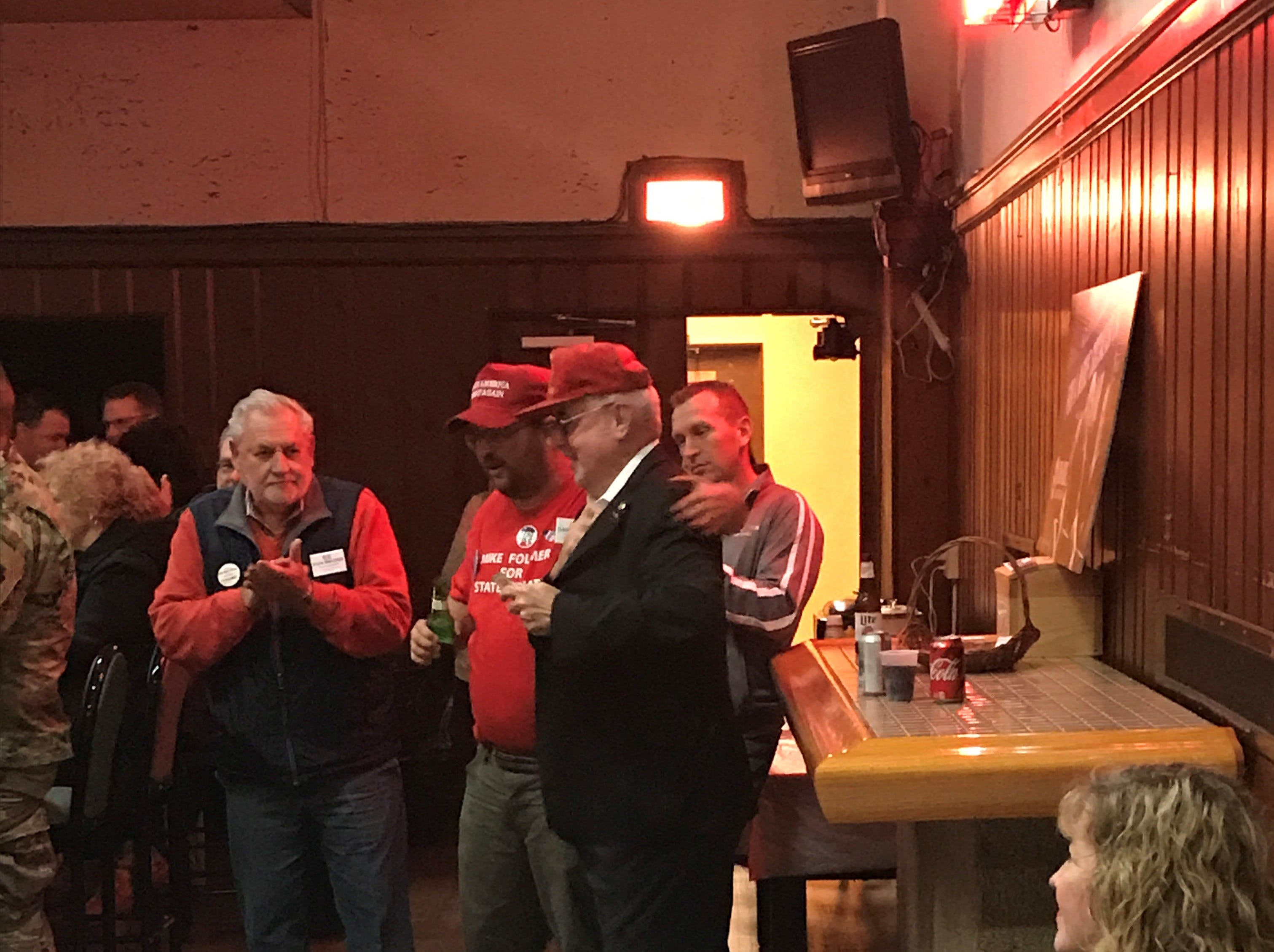 State Rep. Frank Ryan (in the black suit) receives congratulations from fellow Republicans after his election victory was announced Tuesday night.