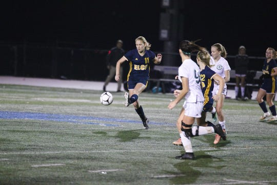 Elco's Julia Nelson looks to clear the ball out of the defensive zone during the Raiders' first round state playoff loss to Lewisburg on Tuesday night.