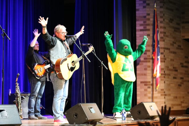 "Chip Richter and the Munks dance with ""Myrtle the Recycling Turtle"" during the ""Earth Jam"" concert for second graders in Port Clinton."