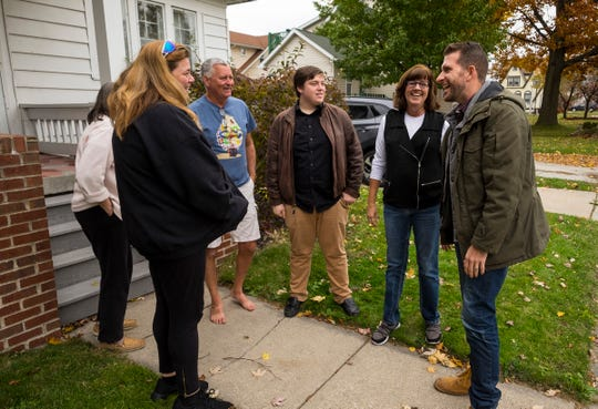 Port Huron Councilman-elect Jeff Pemberton is congratulated by supporters Wednesday, Nov. 7, 2018 at a Port Huron home.