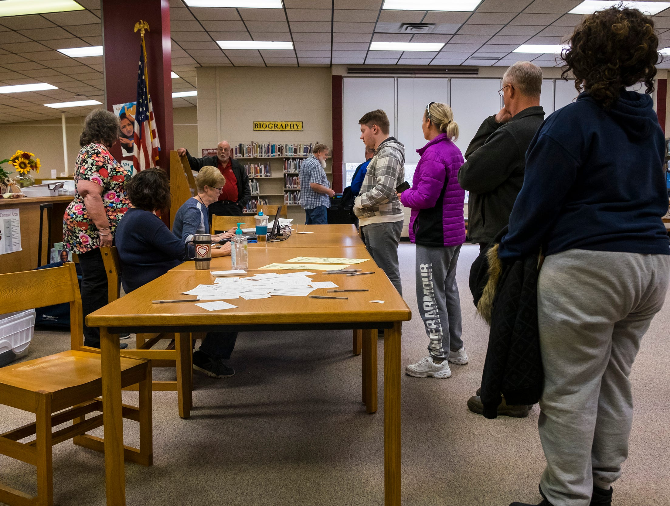 Voters line up to receive their ballots Tuesday, Nov. 6, 2018 in the  Fort Gratiot precinct 2 voting location in Fort Gratiot Middle School's media center.