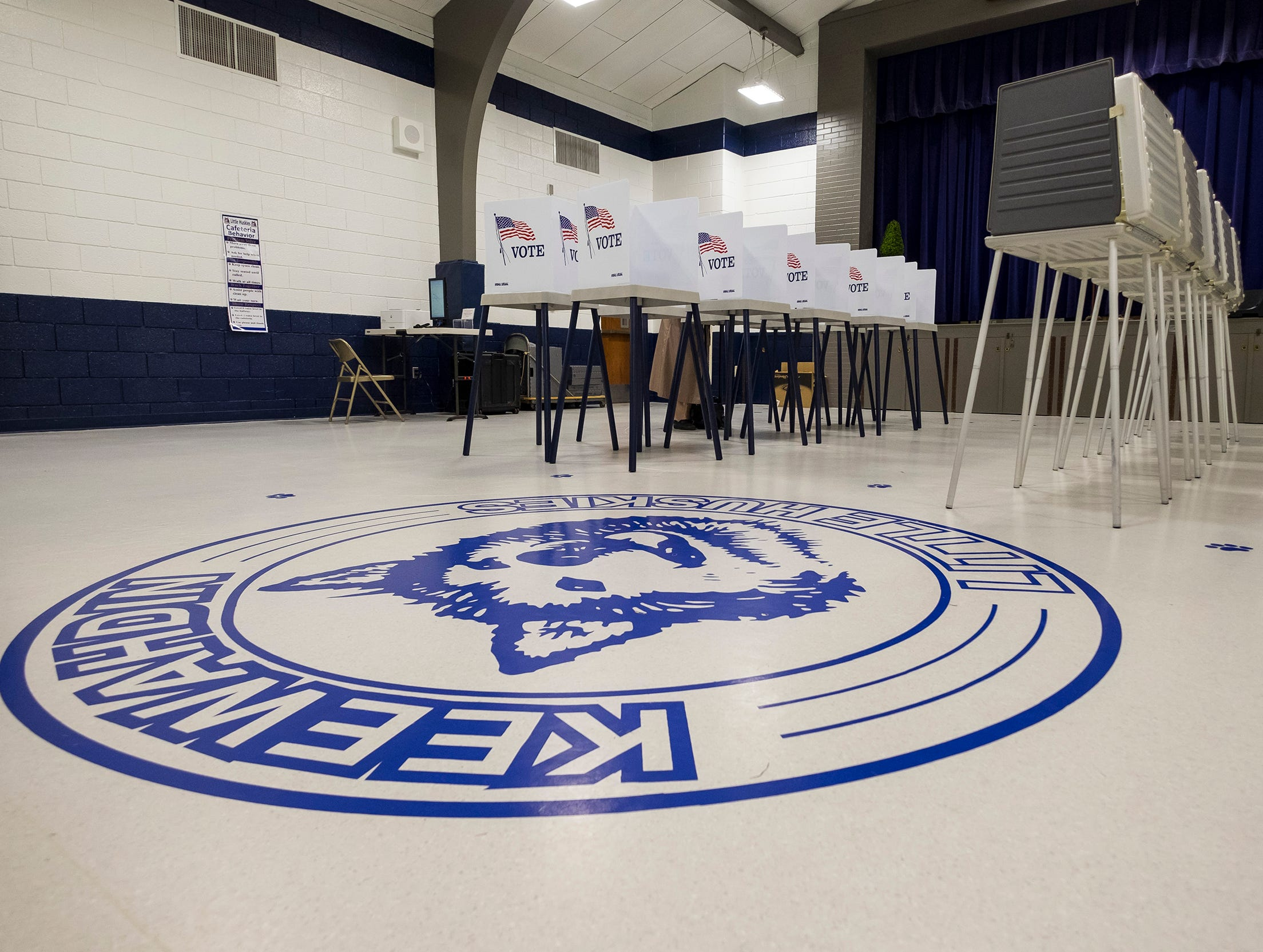 Empty voting booths fill the gymnasium at Keewahdin Elementary Tuesday, Nov. 6, 2018 during mid-term elections. The school was the voting location for Fort Gratiot precinct 1.