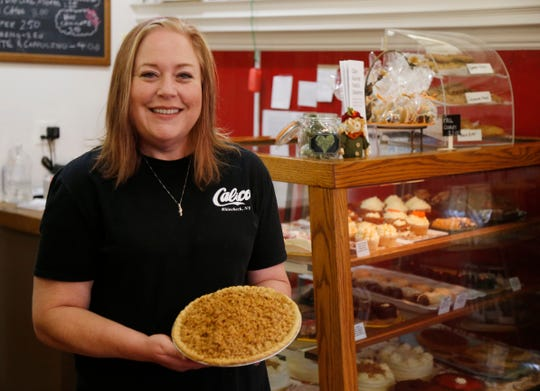 Genia Carter owner of Calico's Gourmet Food and Dessertery in Rhinebeck with an apple crumble pie on November 2, 2018.