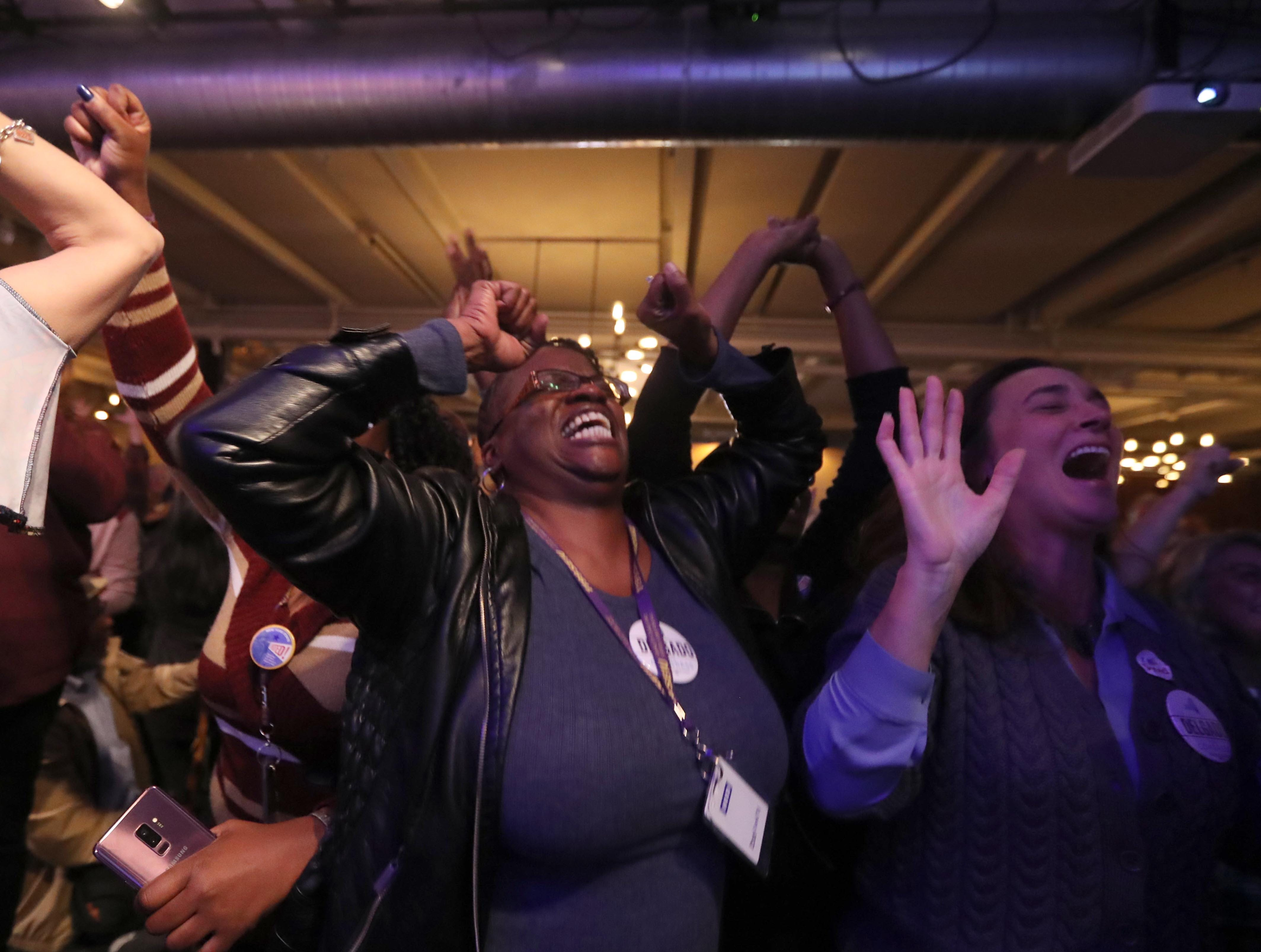 Addie Davis of Poughkeepsie, N.Y. cheers as she and other supporters of congressional candidate Antonio Delgado, watch election results at the Senate Garage in Kingston, N.Y. Nov. 6, 2018. Delgado was running against incumbent Republican John Faso for New York's 19th congressional district seat.