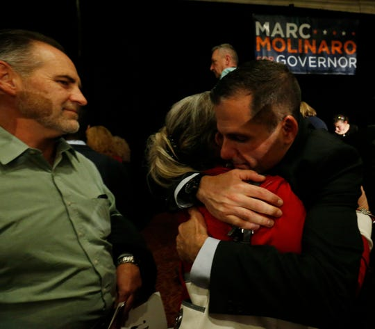 Republican gubernatorial candidate Marc  Molinaro gets a hug from Poughkeepsie resident Lisa Brennan after delivering his concession speech following the results of Tuesday's election in the City of Poughkeepsie on November 6, 2018.