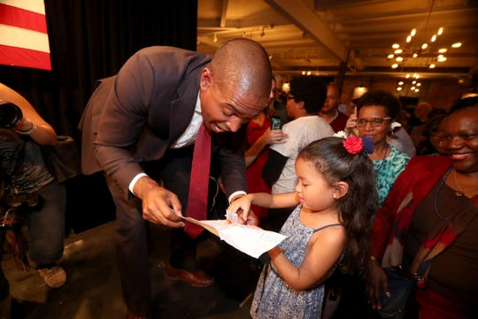 Antonio Delgado gets a home made congratulations card from is niece Melina  after defeating incumbent John Faso in New York's 19th Congressional District race Nov. 6, 2018. Delgado and his supporters were celebrating at the Senate Garage in Kingston, New York.