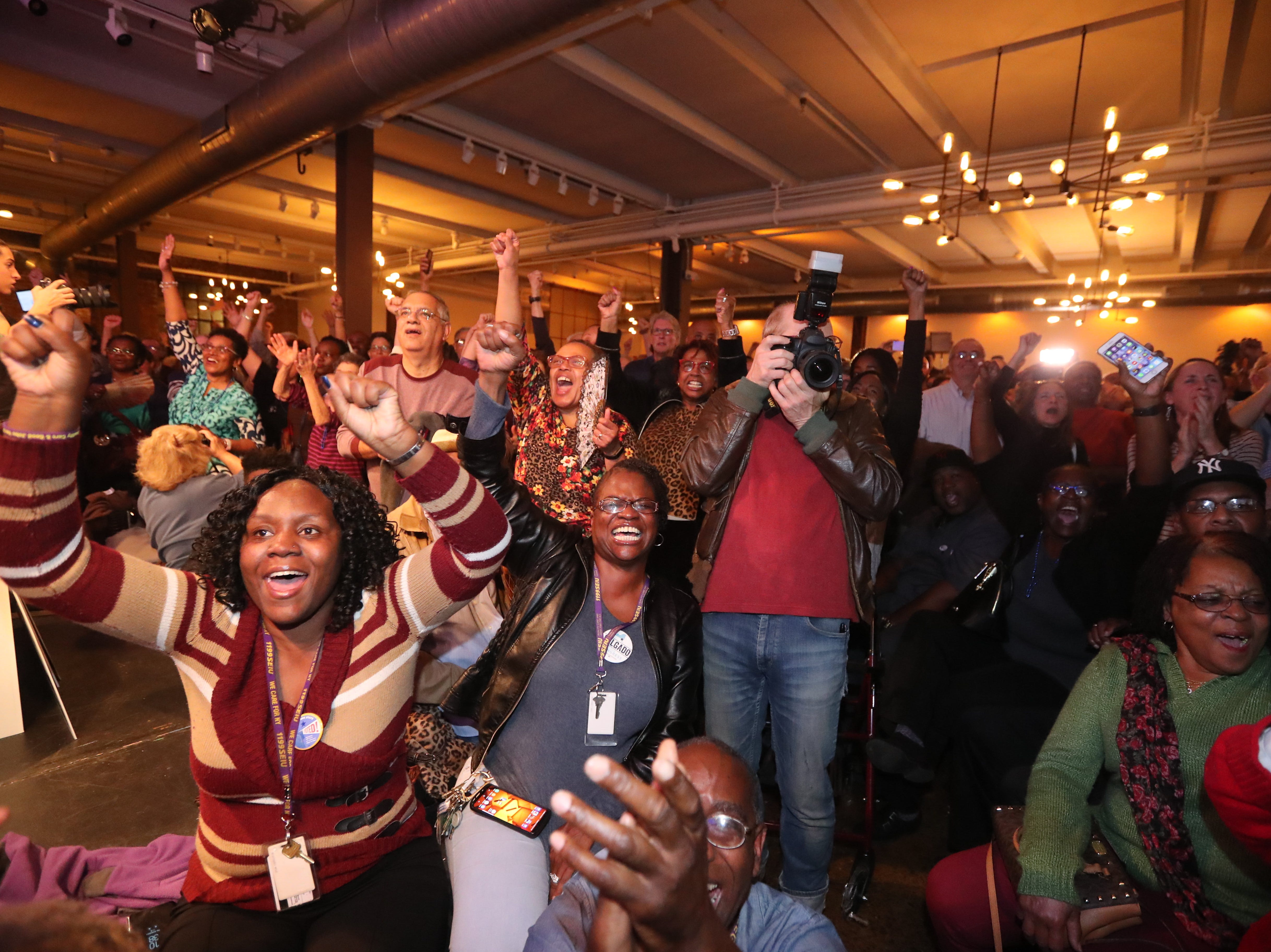Supporters of congressional candidate Antonio Delgado, cheer upon hearing that the Democrats had retaken the House of Representatives while awaiting election results at the Senate Garage in Kingston, N.Y. Nov. 6, 2018. Delgado was running against incumbent Republican John Faso for New York's 19th congressional district seat.