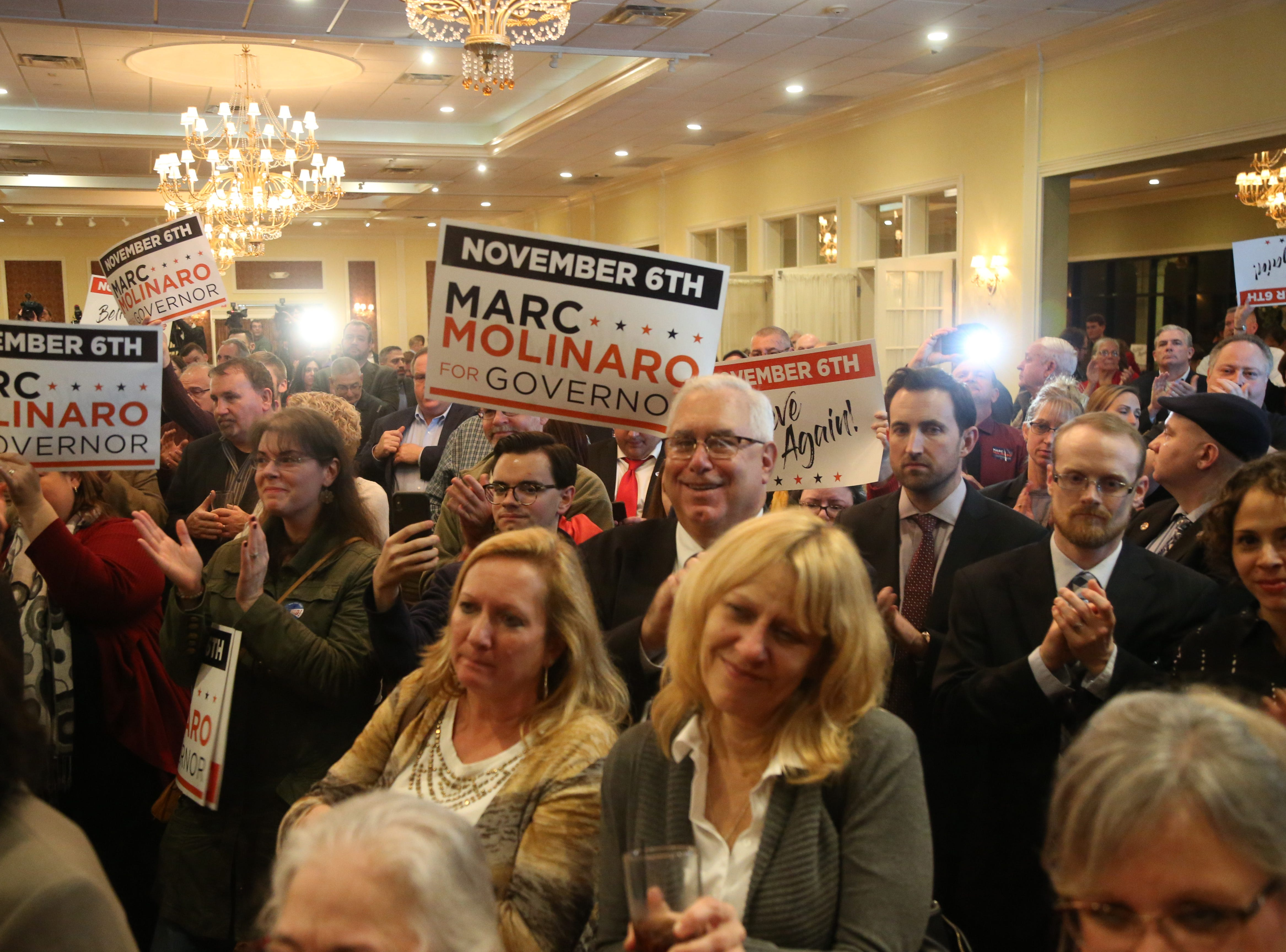 Supporters of Republican gubernatorial candidate Marc Molinaro listen as he delivers his concession speech following the results of Tuesday's election in the City of Poughkeepsie on November 6, 2018.