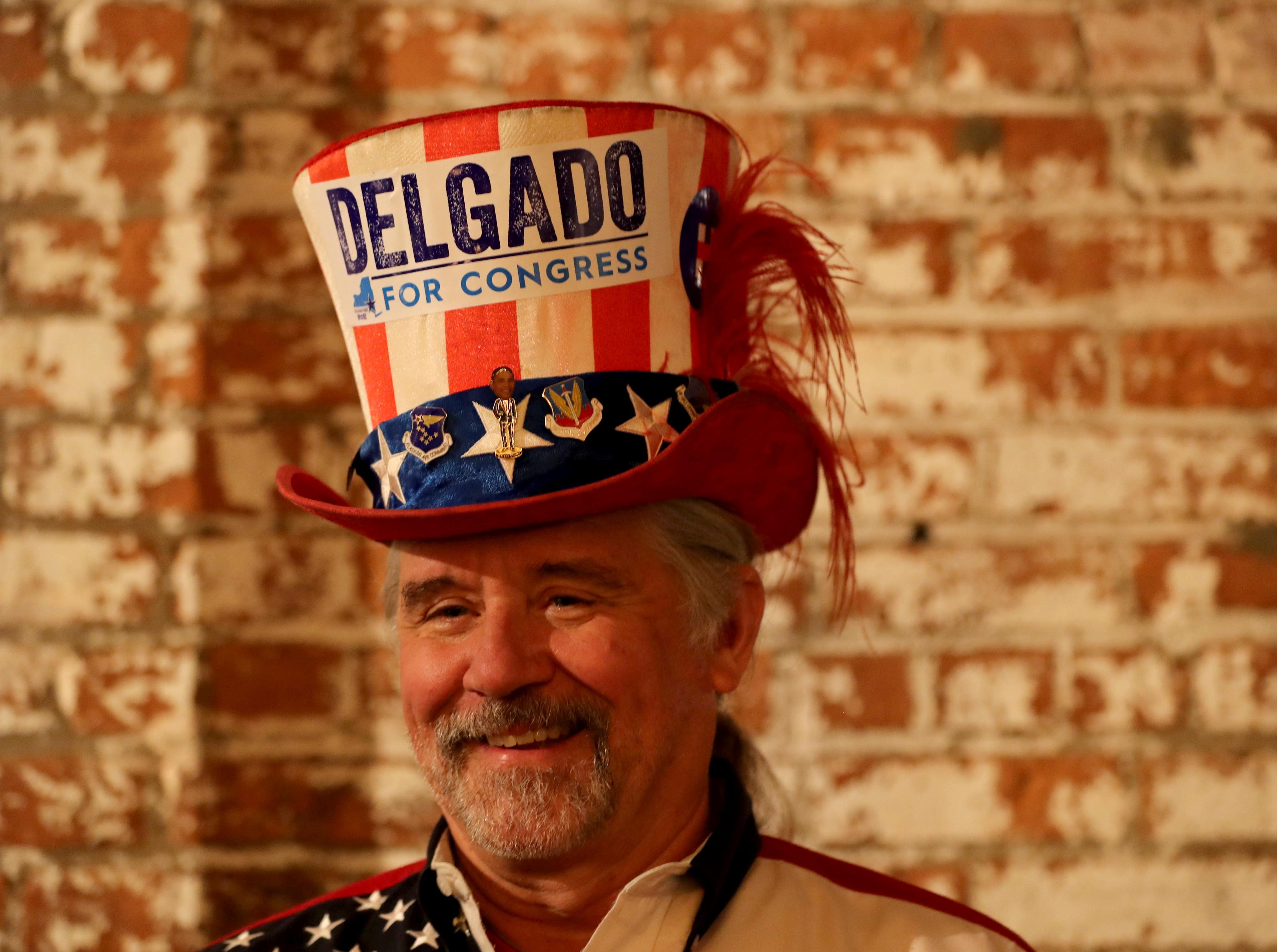 Bill Owens of Pawling, N.Y. a supporter of congressional candidate Antonio Delgado, awaits election results at the Senate Garage in Kingston, N.Y. Nov. 6, 2018. Delgado was running against incumbent Republican John Faso for New York's 19th congressional district seat.