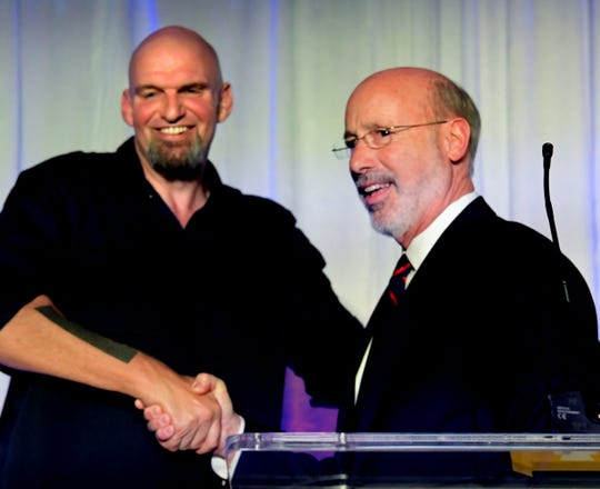Gov. Tom Wolf (at right) and Lt. Gov. John Fetterman shake hands during their campaign's election-night party in York City on Nov. 6, 2018. Wolf is a York County native, and Fetterman was raised in York. (Bill Kalina photo)