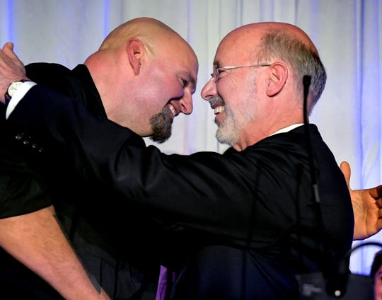 Gov. Tom Wolf and Lt. Gov. John Fetterman embrace  during the campaign's Election Night Party at the Bond in York City Tuesday, Nov. 6, 2018. Wolf defeated challenger Scott Wagner to win a second term. Bill Kalina photo