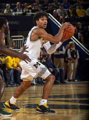 Michigan guard Eli Brooks (55) handles the ball in the first half of an NCAA college basketball game against Norfolk State at Crisler Center in Ann Arbor, Mich., Tuesday, Nov. 6, 2018. Michigan won 63-44. (AP Photo/Tony Ding)