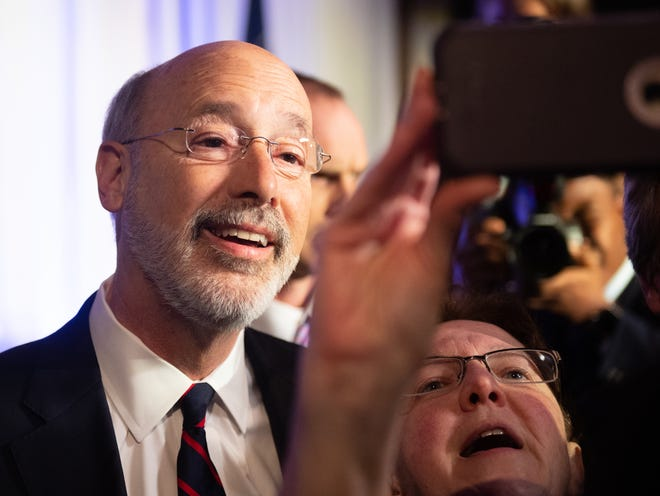 Gov. Tom Wolf celebrates with his supporters during the election night party at The Bond.
