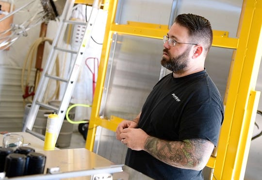 J.R. Heaps talks about running a business next to his brother for nearly the past decade in Fawn Grove, Thursday, Oct. 18, 2018. J.R., who owns South County Brewing, said, 'It feels natural,' about he and his brother's business being side-by-side. His brother, Chris, owns South County Auto.
