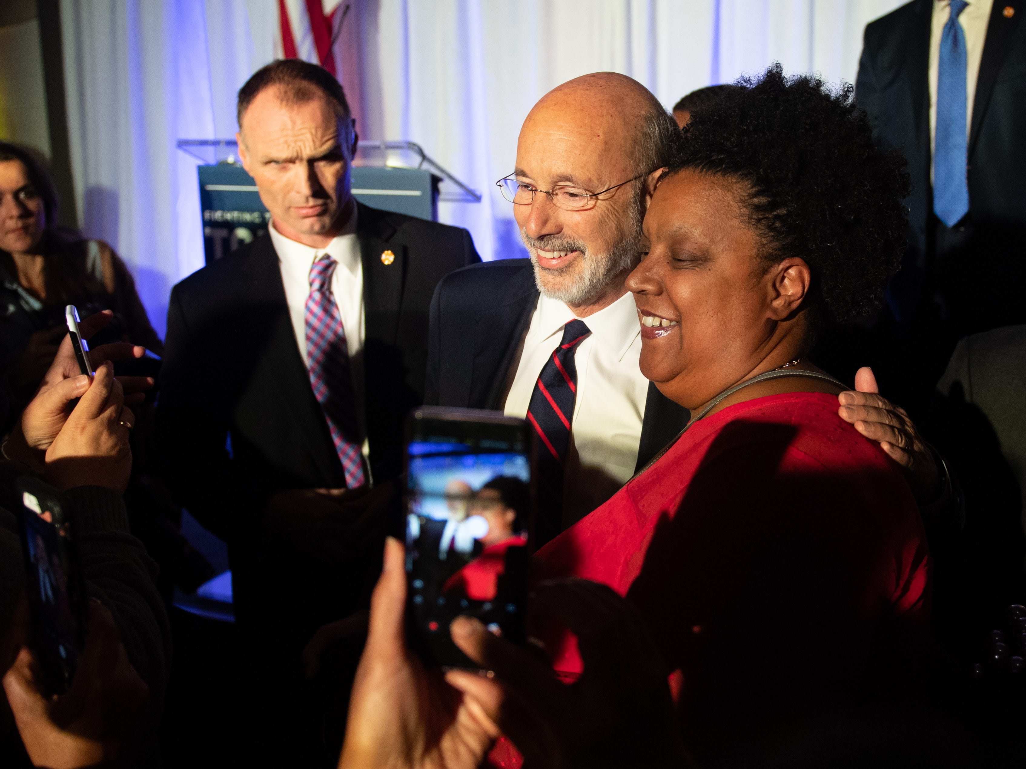 Supporters stand in line to get a picture with the newly re-elected governor on election night. Tom Wolf, center, defeated Scott Wagner for a second term.