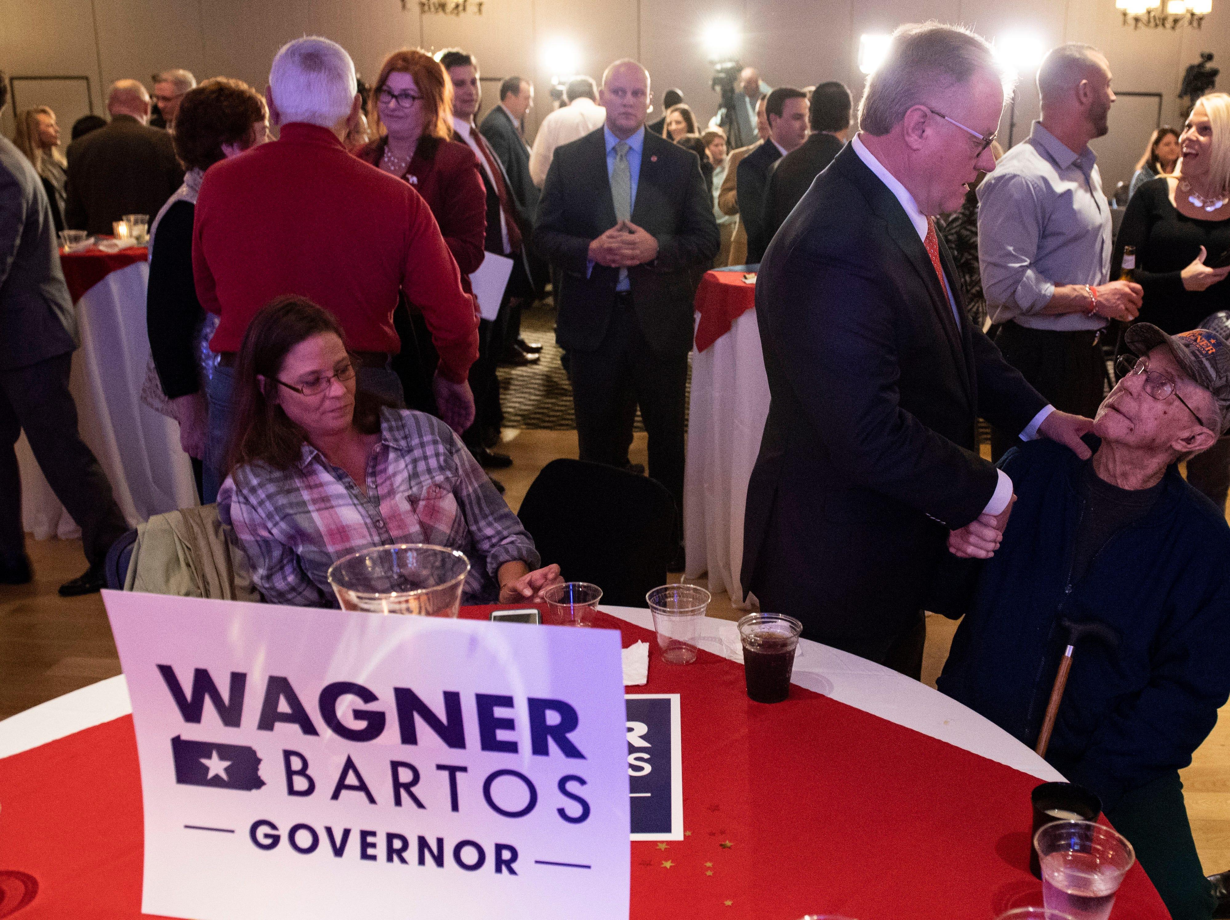 Scott Wagner speaks to his father, Jack Wagner, right, after giving his concession speech at his election watch party at the Wyndham Garden York hotel on Tuesday, Nov. 6, 2018. Wagner lost to Democratic incumbent Tom Wolf. During his concession speech, Wagner said he's not going anywhere.