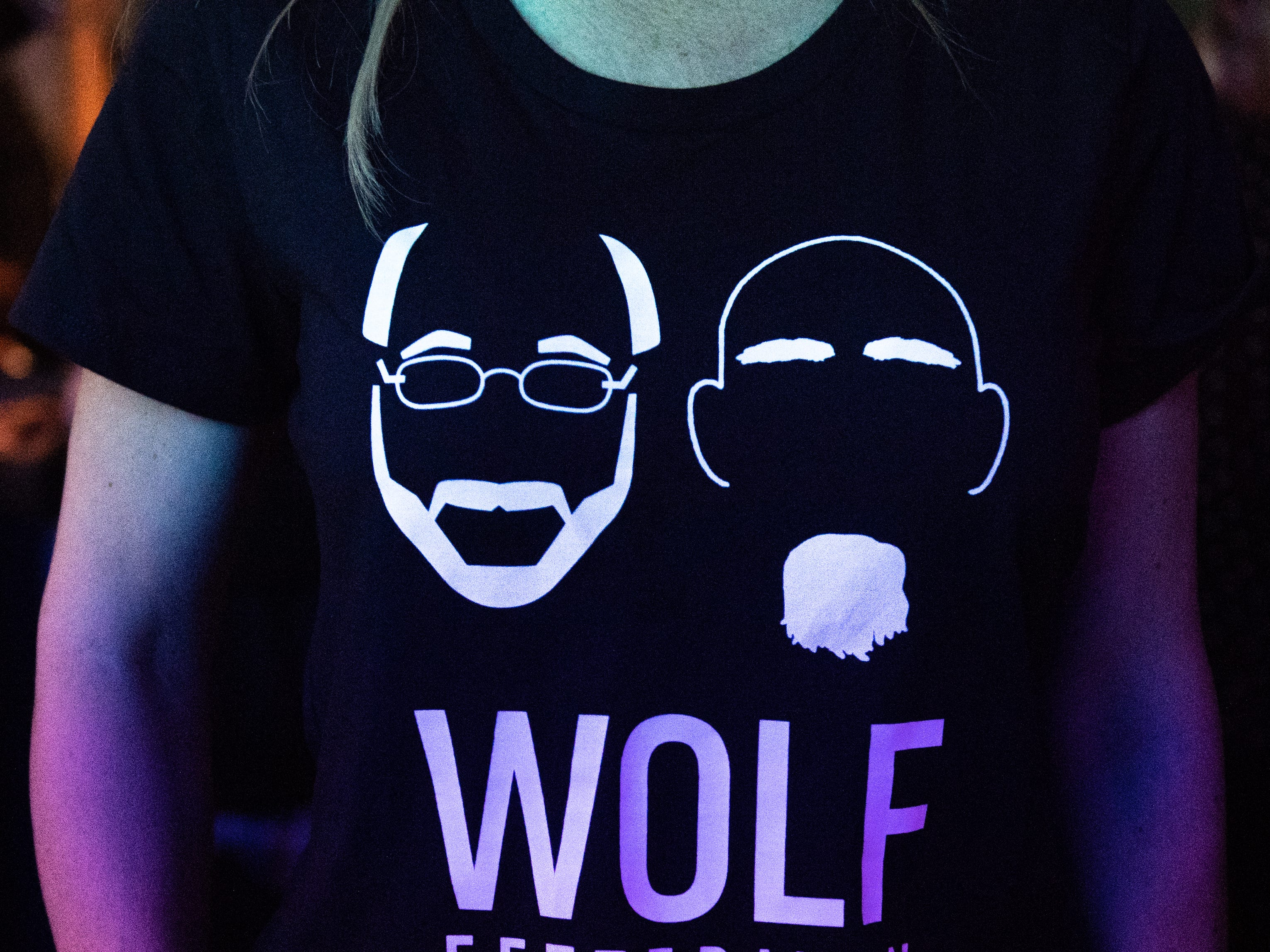 Supporters wore a variety of campaign shirts during the Governor Wolf and Mayor Fetterman Election Night Party at The Bond, Tuesday, November 6, 2018. Tom Wolf was re-elected as Governor of Pennsylvania after defeating Scott Wagner.