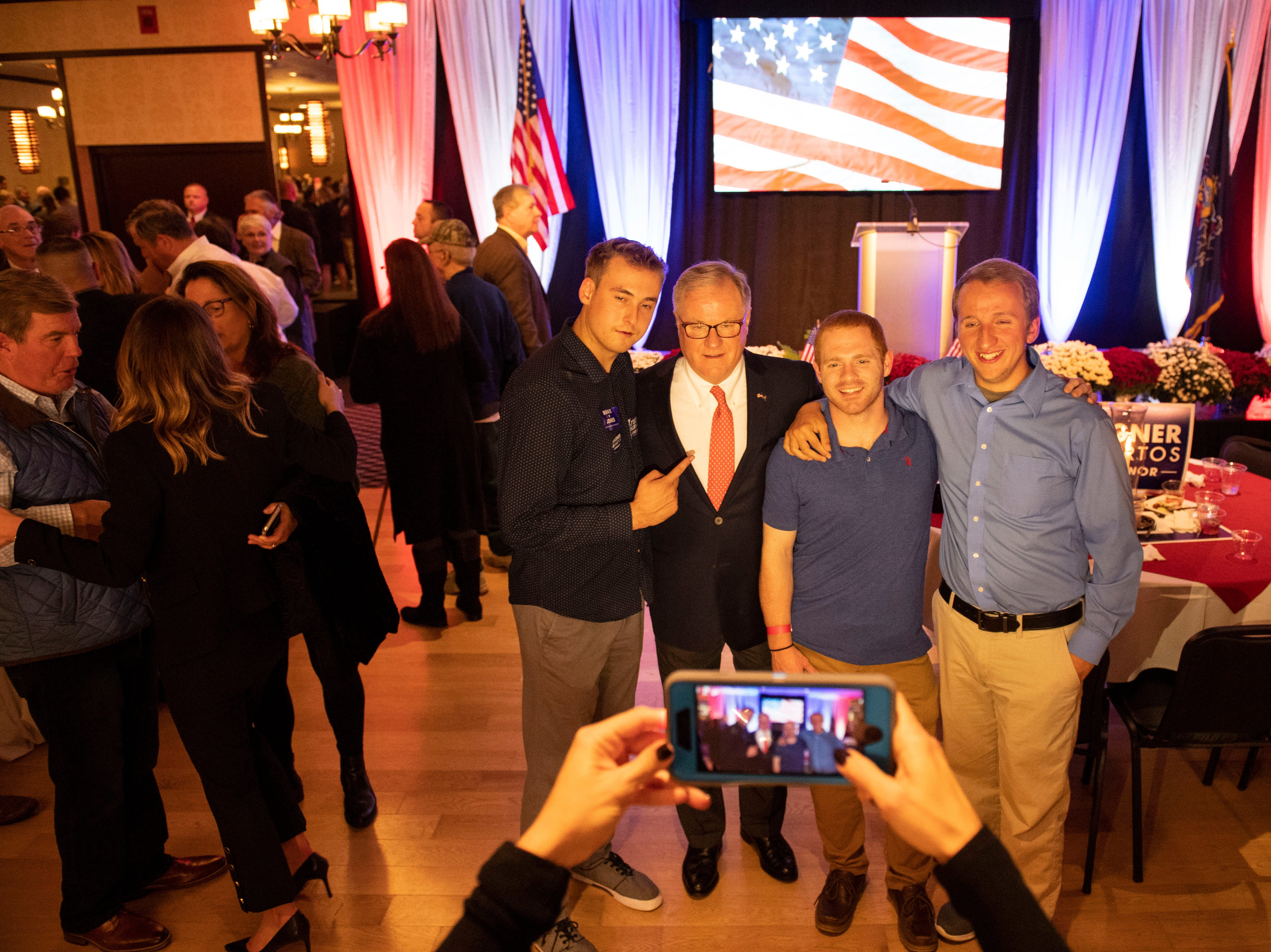 Scott Wagner, second from left, poses for a photo with a group of his supporters following his concession speech at the Wyndham Garden York hotel on Tuesday, Nov. 6, 2018. Wagner lost to Democratic incumbent Tom Wolf. During his concession speech, Wagner said he's not going anywhere.