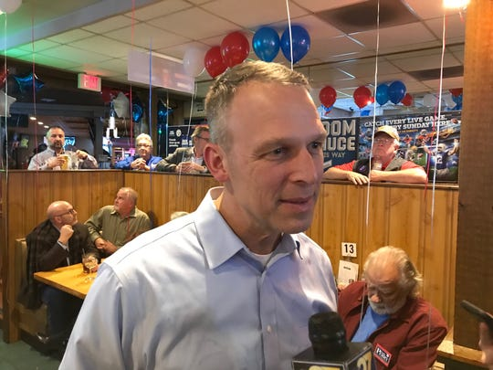 Rep. Scott Perry smiles while talking with reporters during his election night party Tuesday, shortly before George Scott conceded.