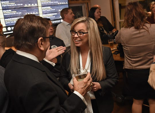 Hillary Schieve mingles with guests at her election watch party at the Brewer's Cabinet on election night Nov. 6, 2018.