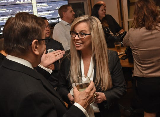 Hillary Schieve mingles with guest at her re-election party at the Brewer's Cabinet on election night Nov. 6, 2018.