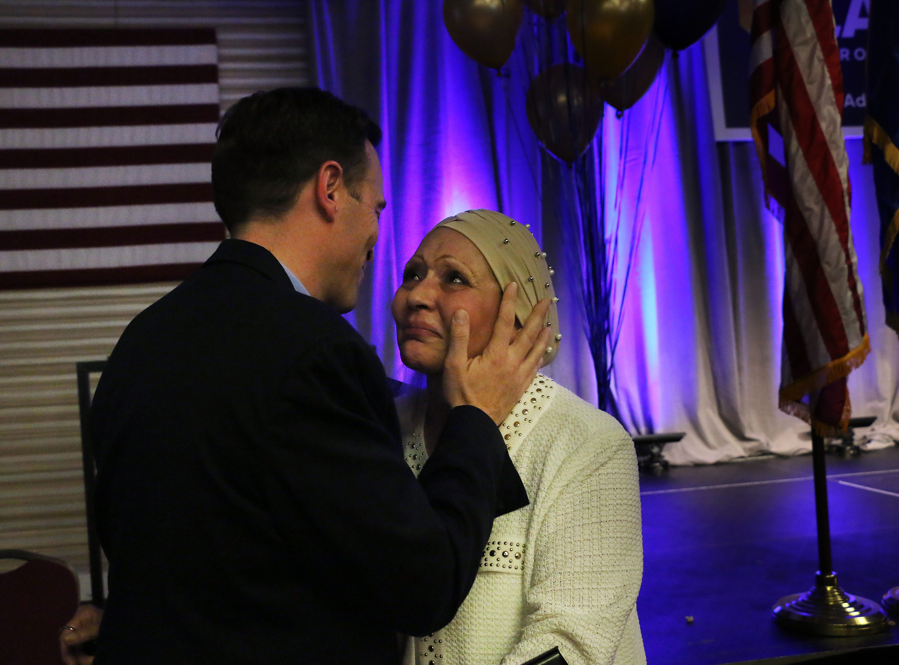 Nevada Attorney General Adam Laxalt greets his mother Michelle after conceding the race for Governor in front of supporters in the Crystal Ballroom in the Grand Sierra Resort in Reno on Nov. 6, 2018.