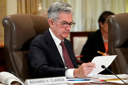 FILE- In this Oct. 31, 2018, file photo Federal Reserve Chair Jerome Powell looks over papers as the Federal Reserve Board holds a meeting at the Marriner S. Eccles Federal Reserve Board Building in Washington. With the economy strong, wages rising and unemployment at a near-five-decade low, the Federal Reserve remains on track to keep raising interest rates, just not this week. After the Fed's latest policy meeting, it's expected to signal a healthy outlook for the economy but to hold off on any further credit tightening, most likely until December. A rate hike in December would mark the fourth this year. (AP Photo/Jacquelyn Martin, File)