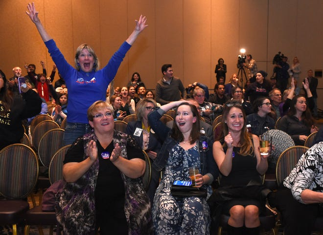Democrats celebrate the election results that show U.S. Senate candidate Jacky  Rosen leading Republican Sen. Dean Heller inside the Reno Ballroom on Nov. 6, 2018.