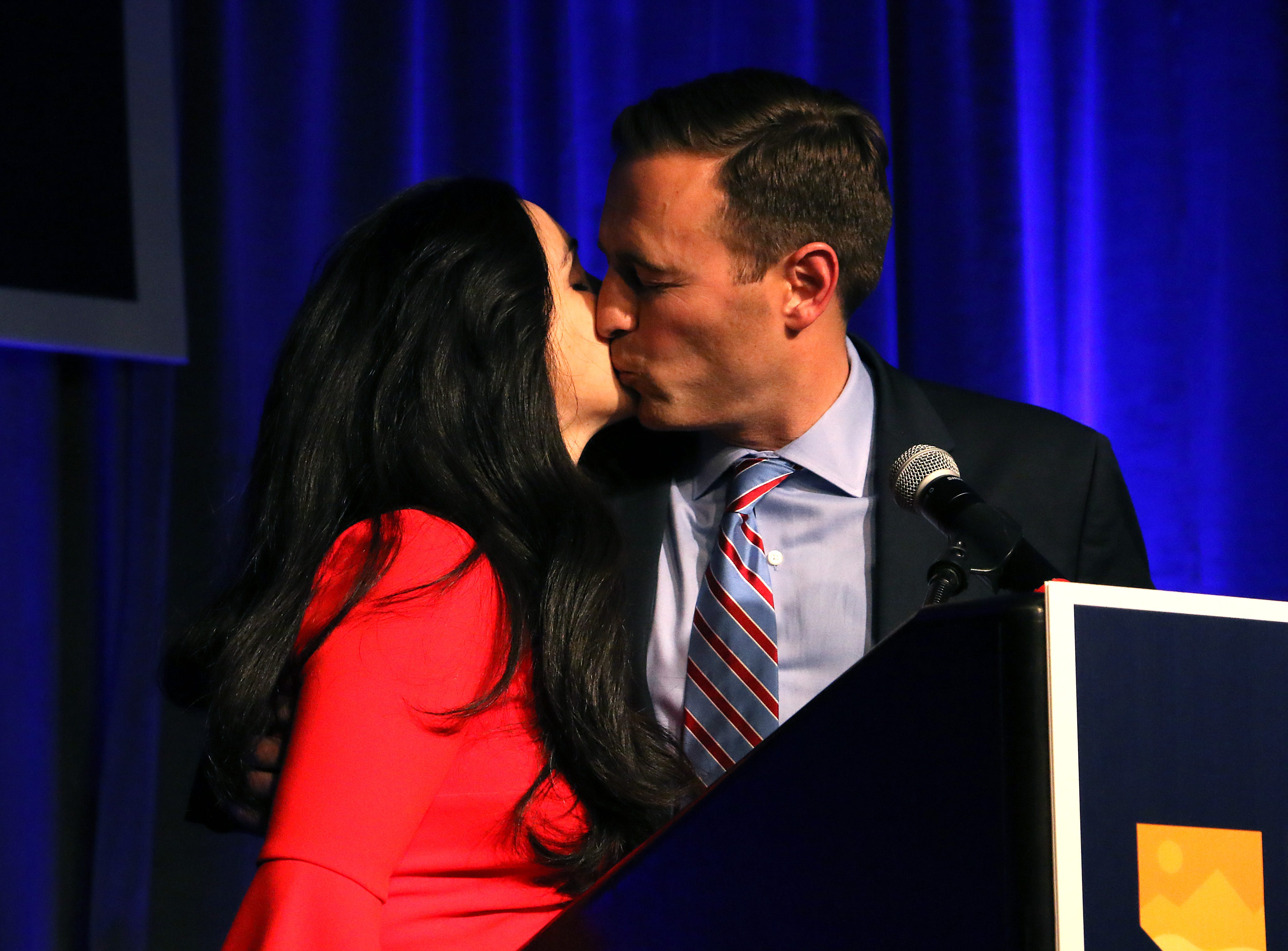 Nevada Attorney General Adam Laxalt kisses his wife Jaime after conceding the race for Governor in front of supporters in the Crystal Ballroom in the Grand Sierra Resort in Reno on Nov. 6, 2018.