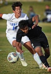 McQueen's Elian Diaz Hernandez and Galena's Jesus Ruiz Alvarez chase the ball during Monday's game at Galena High School.