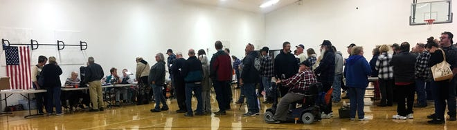 Dayton residents wait in line to cast their votes.