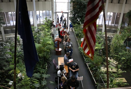 Voters wait in a long line to cast their ballot at the Downtown Reno Library during election day on Nov. 6, 2018. Voters claimed to have waited over an hour to get to the front of the line.
