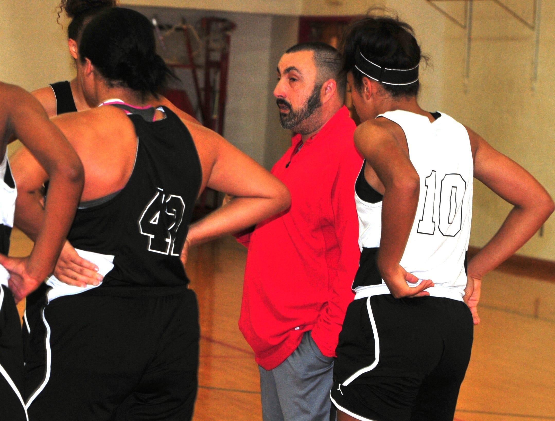 Richmond girls basketball coach Shane Hillard talks to his players during Richmond High School girls basketball practice Monday, Nov. 5, 2018.