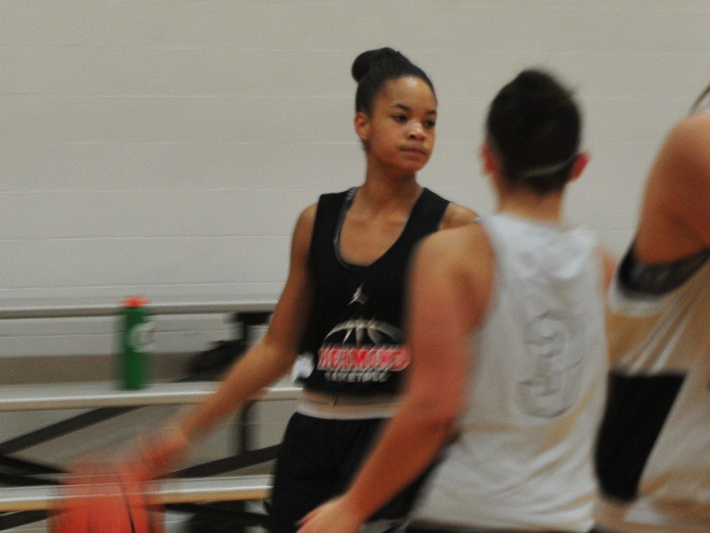 Richmond High School sophomore Nyajah Orr moves the ball during Richmond High School girls basketball practice Monday, Nov. 5, 2018.