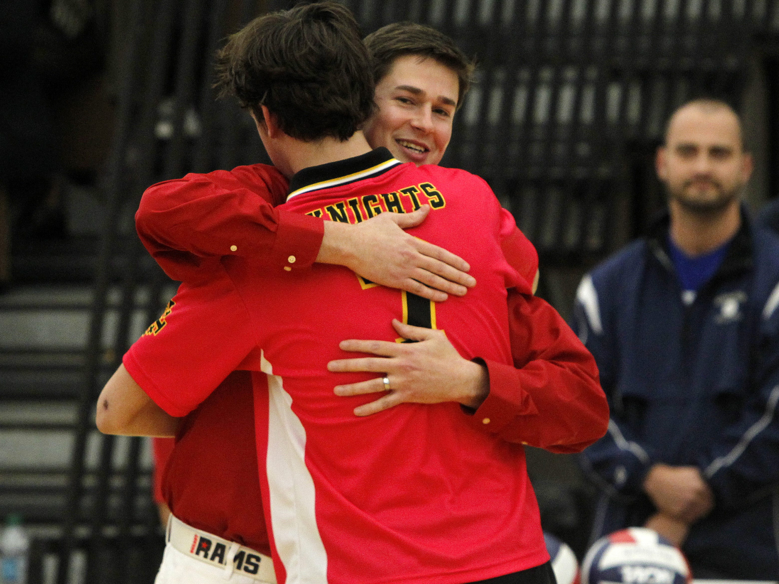 Fairport's head coach John O'Dell, right, hugs his younger brother, McQuaid star Steve O'Dell, prior to boys volleyball action between the Fairport Red Raiders and the McQuaid Jesuit Knights at Webster Schroeder high school in Webster Thursday evening, November 10, 2011. McQuaid won the title in straight sets.