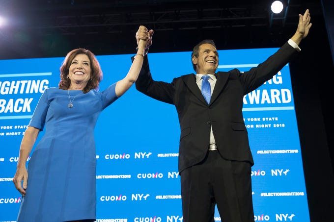 New York Gov. Andrew Cuomo, right, stands with Lieutenant Governor Kathy Hochul during an an election night watch party hosted by the New York State Democratic Committee, Tuesday, Nov. 6, 2018, in New York.