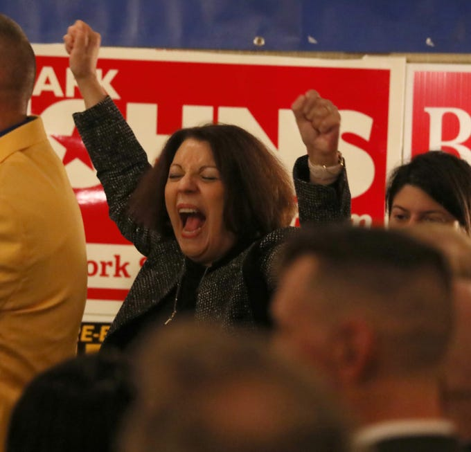 Judge Ann Marie Taddeo celebrates as she takes the stage with her fellow Republicans at the Monroe County Republican Committee election night headquarters at the Rochester Riverside Hotel in downtown Rochester Tuesday, Nov. 6, 2018.  Judge Taddeo was re-elected to New York State Supreme Court.