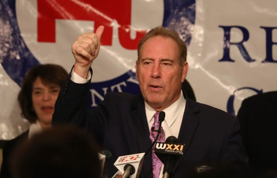 Senator Joseph Robach gives a thumbs up to supporters after winning re-election at the Rochester Riverside Hotel in downtown Rochester Tuesday, Nov. 6, 2018.