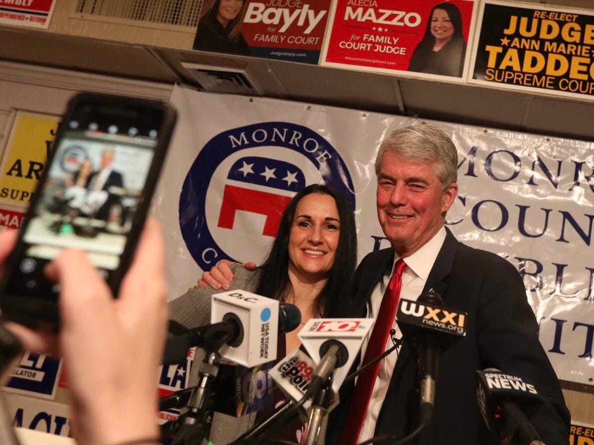Republican candidate for Congress Jim Maxwell poses for a photo with friend Danielle Stout, at the Rochester Riverside Hotel on Election night.
