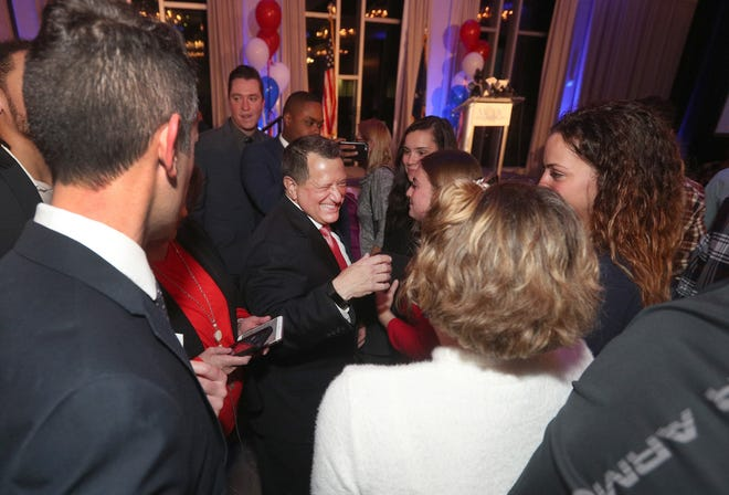 Joe Morelle makes his way through the crowd after winning the congressional seat in New York's 25th district.