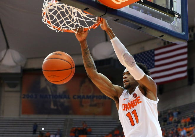 Syracuse forward Oshae Brissett slams home two of his 20 points during the Orange's victory over Eastern Washington on Tuesday.