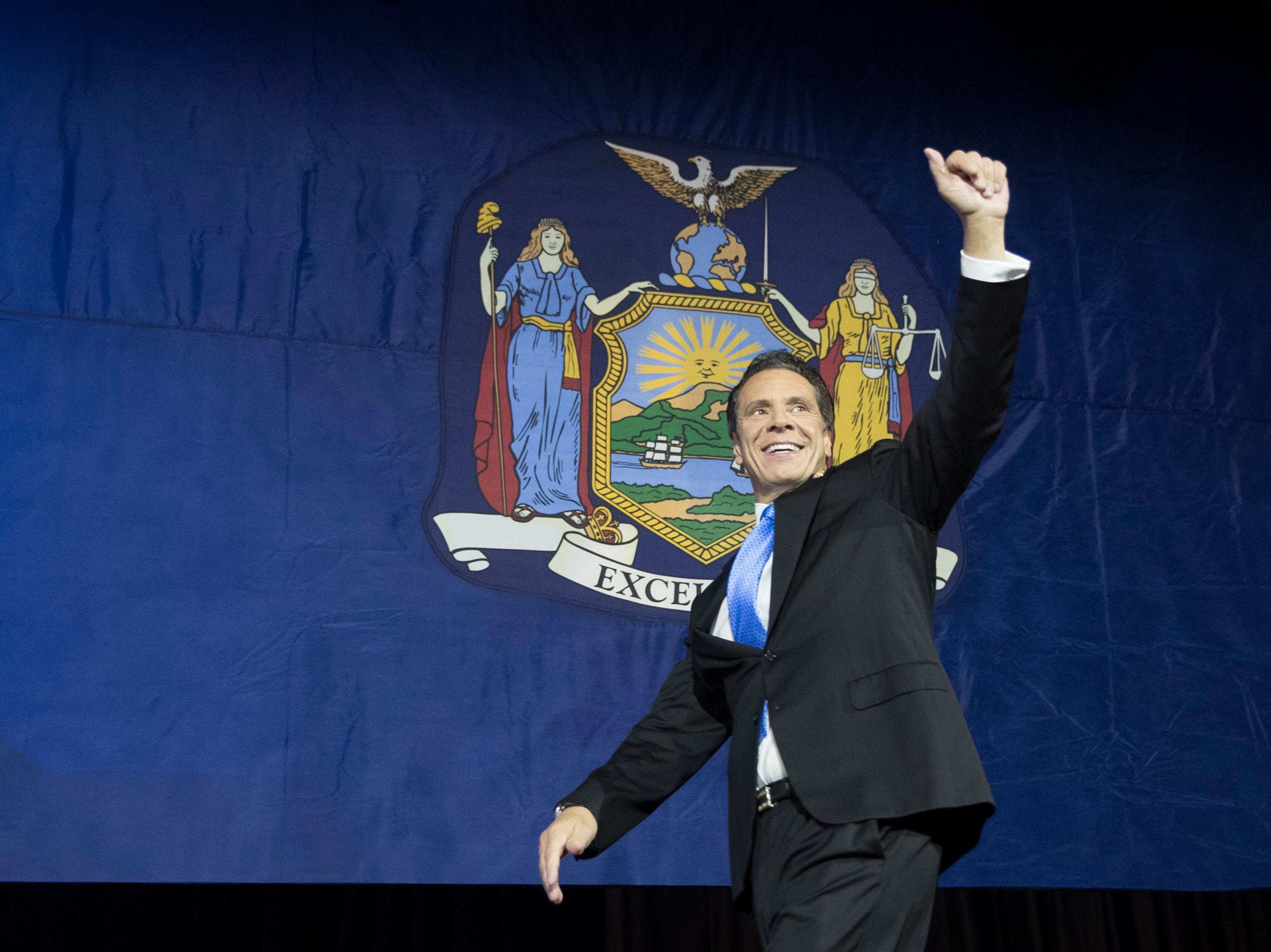 New York Gov. Andrew Cuomo arrives on stage after being reelected during an election night watch party hosted by the New York State Democratic Committee, Tuesday, Nov. 6, 2018, in New York.
