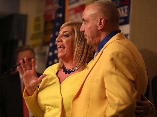 Judge Vicki Argento, with husband Larry, thanks all who helped with her campaign after her victory for State Supreme Court at the Monroe County Republican Committee election night headquarters at the Rochester Riverside Hotel in downtown Rochester Tuesday, Nov. 6, 2018.