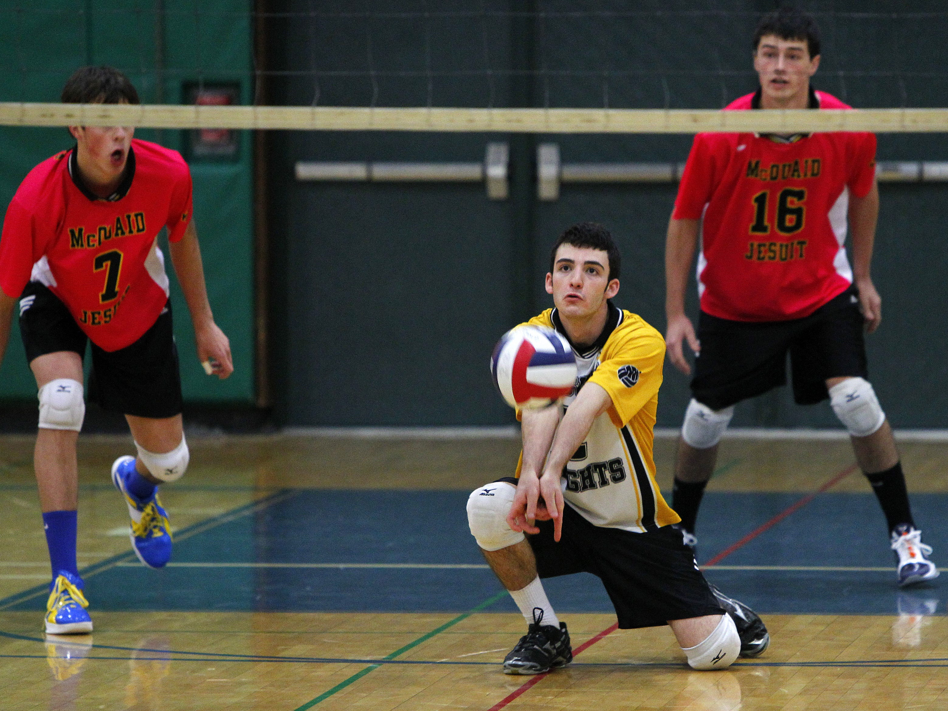 McQuaid's A.J. Logosh, center, looks to pass a ball to the front line during NYSPHSAA Division I boys volleyball championship between the McQuaid Jesuit Knights and the Massapequa Chiefs at Cicero-North Syracuse High School in Cicero Saturday afternoon, November 19, 2011.