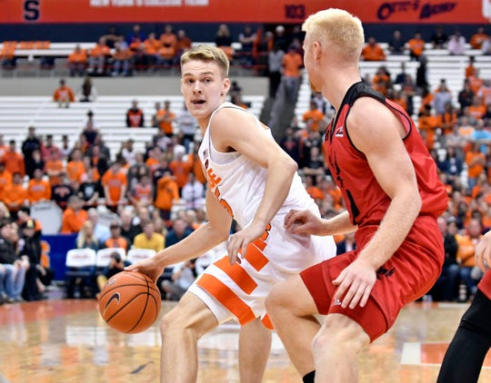 Syracuse guard Buddy Boeheim , left, struggled with his shooting in his college debut. Going 1-for-11 and 0-for-5 from 3-point range.