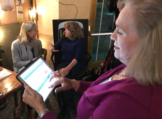 Redding Mayor Kristen Schreder checks the results for Measure C, the city's proposed cannabis business tax, on Tuesday night at Carnegie's. Redding voters gave overwhelming approval to the new tax while Schreder ended in third place to fill three City Council seats.