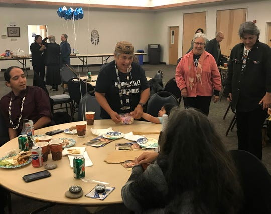 Caleen Sisk, center, shares a laugh with friends during an election night party in the Redding Rancheria Community Room in Redding.